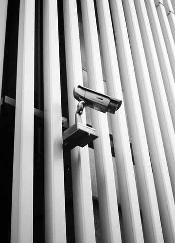 secuirty camera on a fence